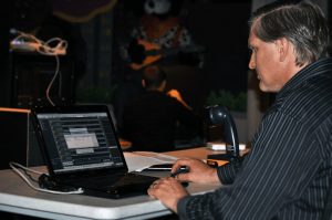 Don Nolan of Entertainment Sciences Group works on customizing VenueMagic SC+